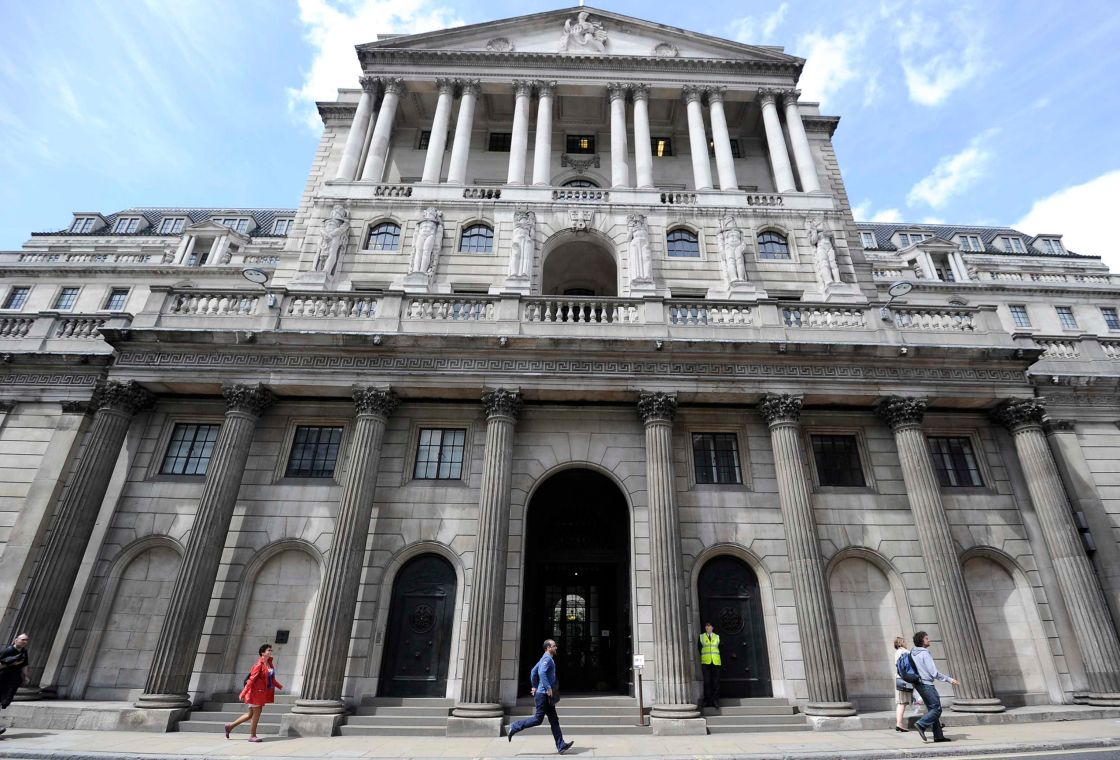 People walk and jog past the Bank of England