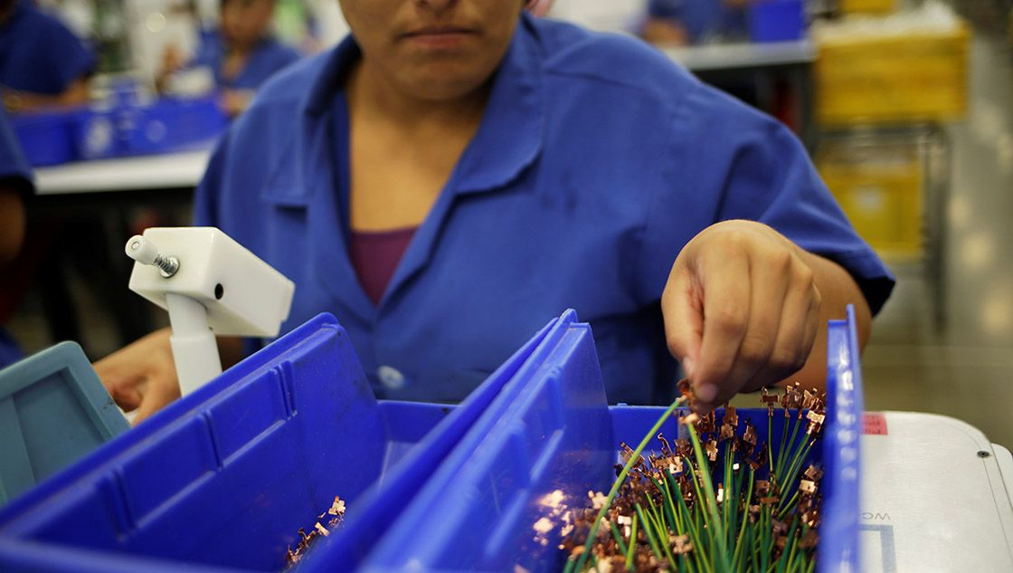 An employee works at Ark de Mexico, an assembly factory that makes wire harnesses and electric components for the automobile industry, in Ciudad Juarez
