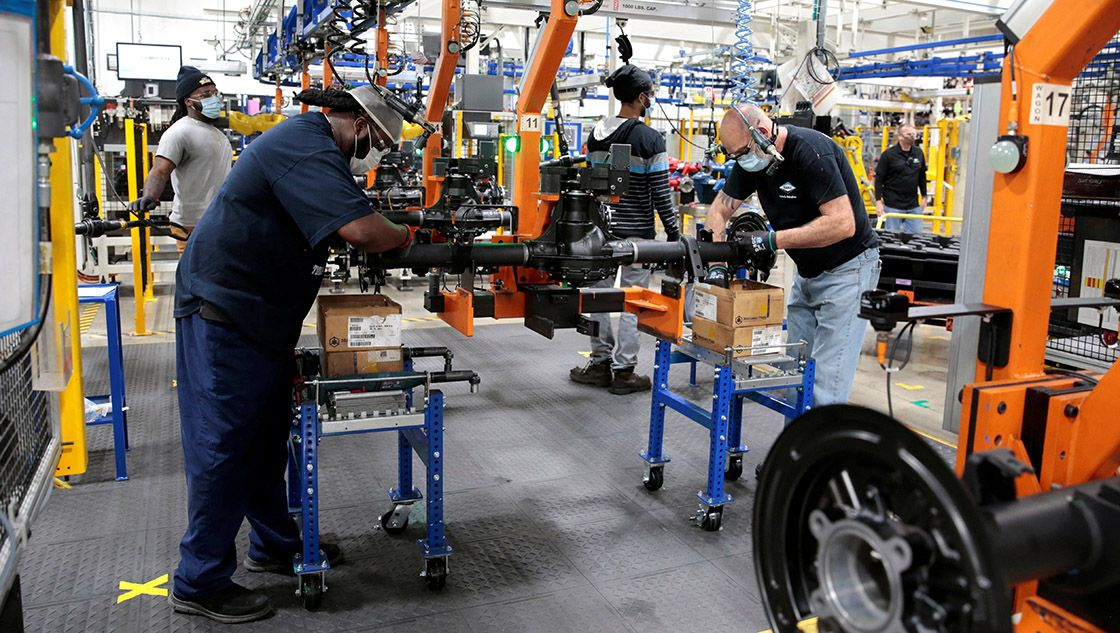 FILE PHOTO: Dana Inc. assembly technicians wear face masks as they assemble axles for automakers, amid the coronavirus (COVID-19) outbreak, in Toledo